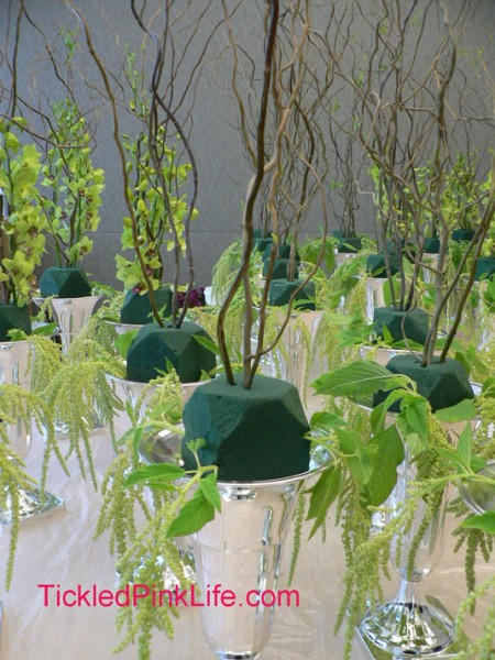 table arrangement preparation-inserting amaranthus and curly willow into oasis
