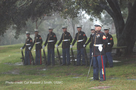 US Marine Corp honor guard at funeral in the rain