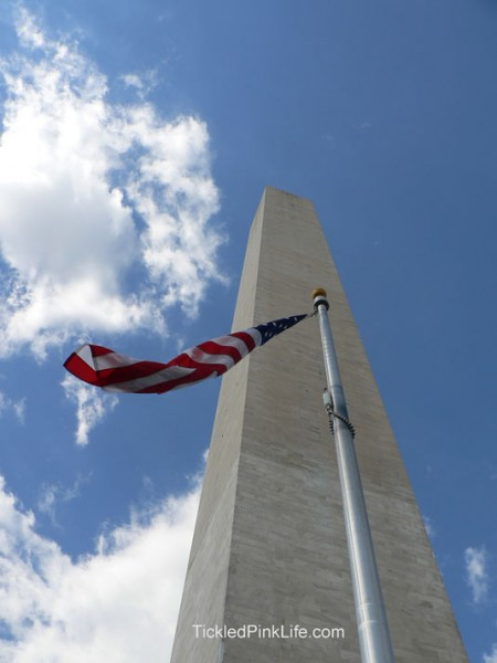 Washington Monument with American flag-celebrating the fourth of July