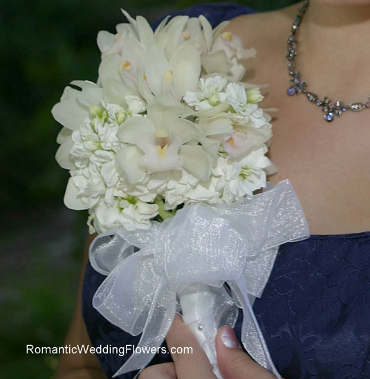 white orchid and stock bouquet