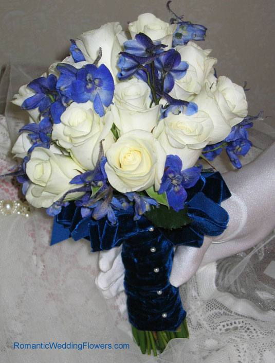 blue delphinium white rose bouquet