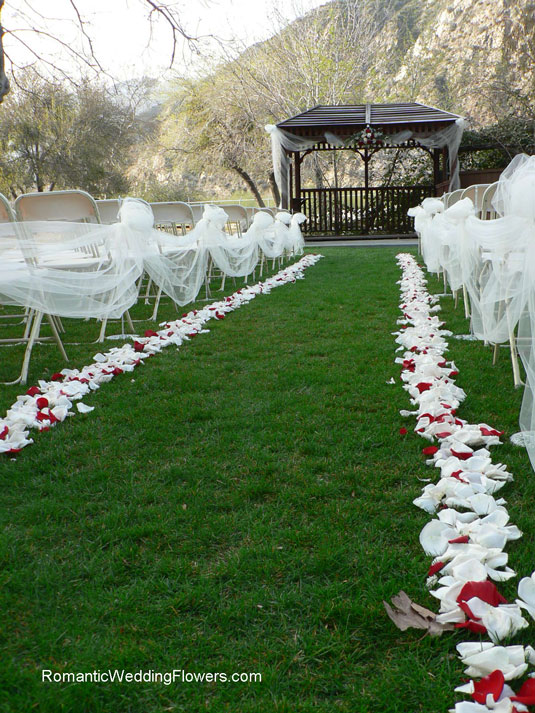 rose petal and tulle lined aisle Green Mountain Ranch