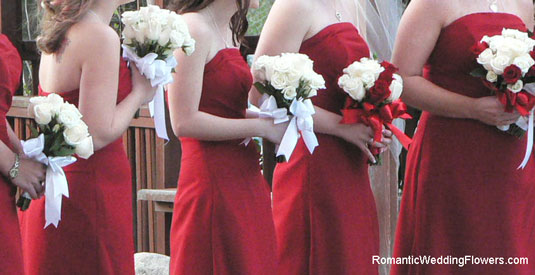red bridemaid dresses rose bouquets