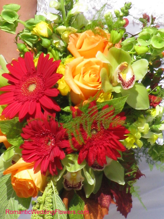 red gerberas yellow roses green cymbidium orchids