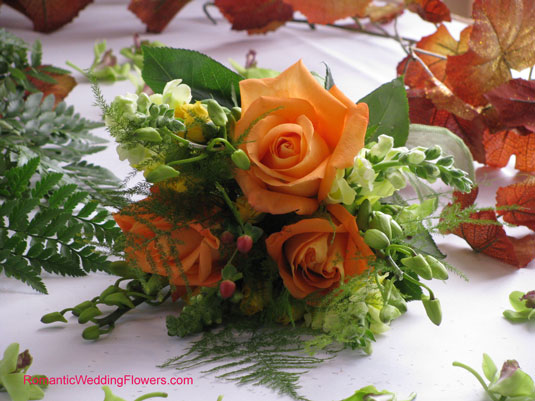 orange rose and snapdragon toss bouquet