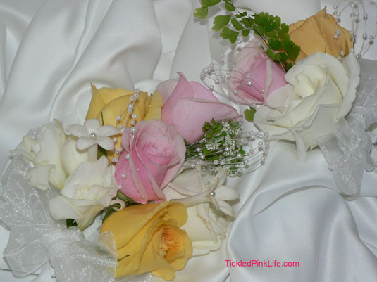 pink yellow roses stephanotis corsages
